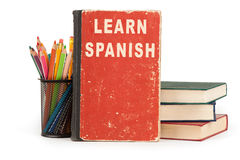 Learn spanish language. school supplies on white. Learn spanish language. school supplies isolated on white background Royalty Free Stock Images