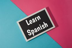 Learn Spanish - text on chalkboard Stock Image