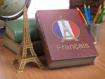 Learn and studiyng French concept. Book with  French flag and Ei Royalty Free Stock Images