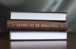 Learn to be beautiful.Book concept. Stock Image
