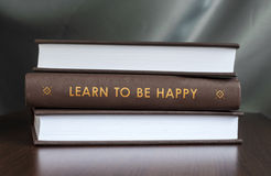 Learn to be happy. Book concept. Stock Photography