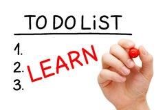 Learn To Do List. Hand writing Learn in To Do List with red marker isolated on white stock photo