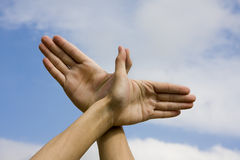 Learn to fly. Hand with the Sky Background Stock Photos