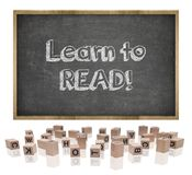 Learn to lead concept on blackboard with wooden Royalty Free Stock Images