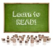 Learn to lead concept on blackboard with wooden Stock Photo
