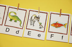 Learn to read. Alphabetic character on cards in classroom Royalty Free Stock Images
