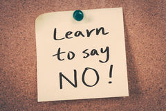 Learn to say no. Message on a cork board stock photography