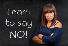 Learn to say no teacher threatening brunette woman crossed arms. Blackboard or chalkboard Royalty Free Stock Images