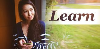 Composite image of learn word. Learn word against smiling student with smartphone looking through window Stock Images