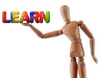 Learn word manikin. Manikin model holds multi-colored word learn Royalty Free Stock Photos