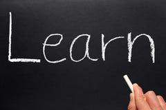 Learn written on a blackboard. Royalty Free Stock Images
