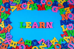 Learn written by plastic colorful letters Stock Photos