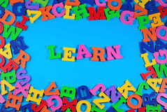Learn written by plastic colorful letters Stock Photography