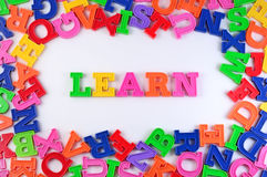 Learn written by plastic colorful letters on a white Stock Photo