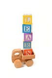Learn written with play blocks on wooden toy truck Stock Photo