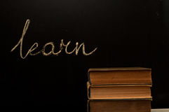 Learn written on school blackboard. With books Royalty Free Stock Images