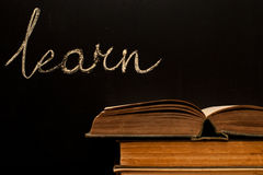 Learn written on school blackboard Stock Photos