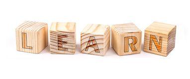 Learn written on wooden blocks. Isolated on white background Stock Photo