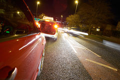 Learner Driver. On a busy road at night Stock Images