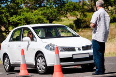 Learning to drive. Learner driver girl with instructor taking lessons Royalty Free Stock Photos