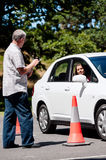 Learning to drive. Learner driver girl with intstructor taking lessons Royalty Free Stock Image