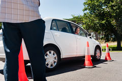Learning to drive. Learner driver girl with intstructor taking lessons Stock Photography