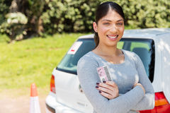 Learner driver holding license. Happy learner driver holding her driver's license Stock Images