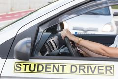 Learner driver student driving car with instructor Stock Image
