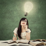 Learner getting idea and look at light bulb Stock Image