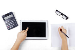 Learner hand touching tablet screen Royalty Free Stock Images