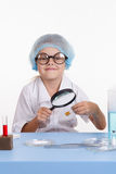 Learner identifies the powder under a magnifying glass Stock Image