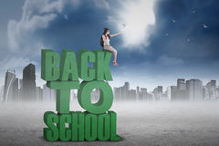 Learner releases doves from a text of back to school Stock Image