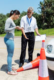 Learner running traffic cones. Young driving learner running over traffic cones stock image