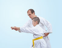 The learner with a yellow belt karate coach corrects stock photography