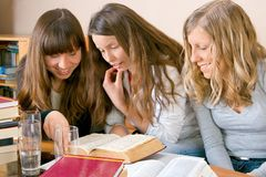Learnig Together. Three girls learning from books Royalty Free Stock Image