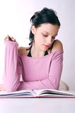 Learning. Young student reading a lesson Royalty Free Stock Image