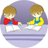 Learning. Two brothers were studying diligently Stock Photography