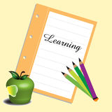 Learning. Abstract colorful background with colorful pencils, bitten apple and a piece of paper on which is written the word learning Royalty Free Stock Image