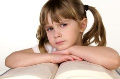 Learning. A young girl reading a book stock image