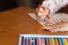 Learning. Hands of child painting on paper Royalty Free Stock Image
