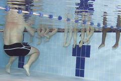 Learning. Underwater picture of a swimming class for young children Royalty Free Stock Images