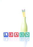 Learning. Learn Written With Alphabet Blocks With Vase Holding Pencils Royalty Free Stock Images