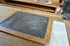Learning. Vintage chalkboard in an old school house built around 1890 AD Royalty Free Stock Photos