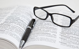 Learning. Glasses on pile of white books Stock Photos