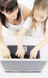 Learning. Mother and daughter with computer Royalty Free Stock Images
