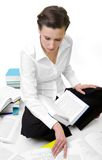 Learning. Casual student with books spread around royalty free stock image