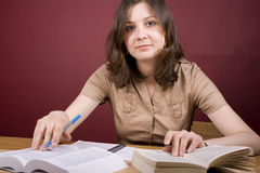 Learning. Pretty, young woman studying in a home environment Stock Photos