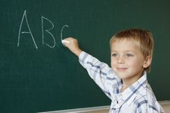 Learning abc. Little boy just writing abc stock photography