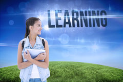 Learning against green hill under blue sky Stock Photography