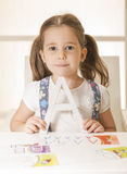 Learning alphabet. Beautiful little girl posing with letter A. Learn Study Education School Knowledge Concept Stock Photography